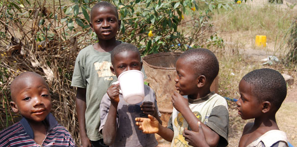 VillageWater:  African Children Drinking Reliable, Safe Drinking Water